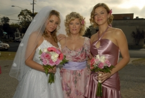 Tyra (on the right) with her mom and sister on her sis' wedding day